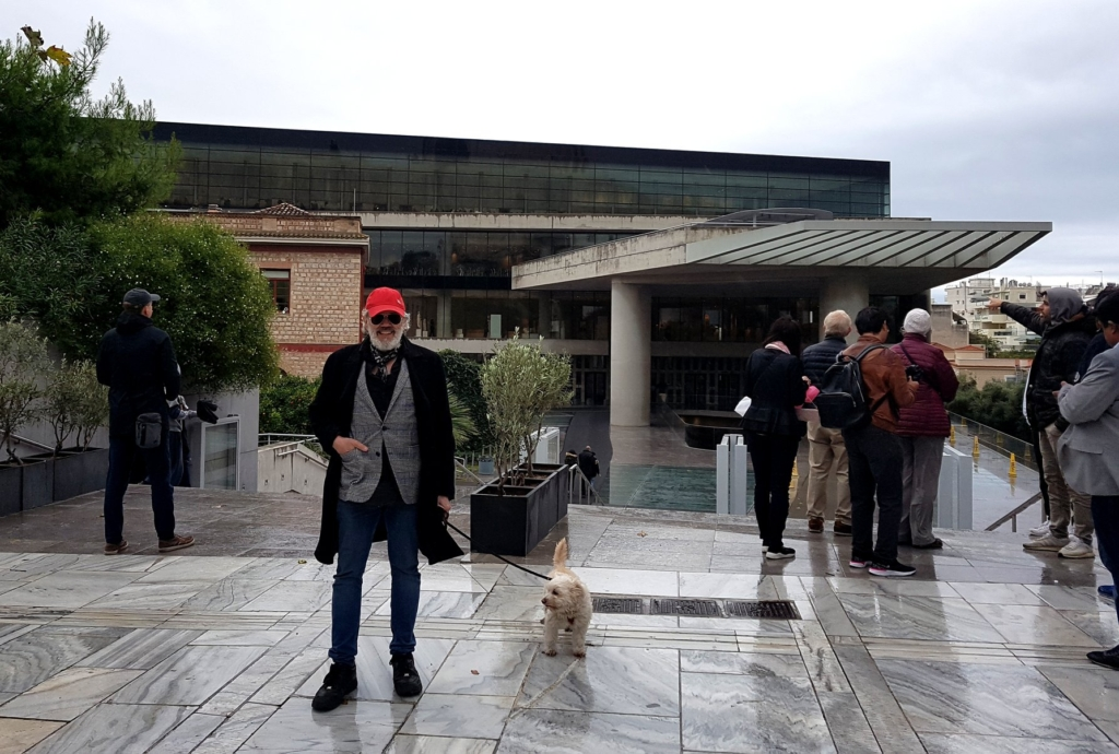 Pantelis Melissinos and celebrity canine Poy-Poy in front of the new Acropolis Museum